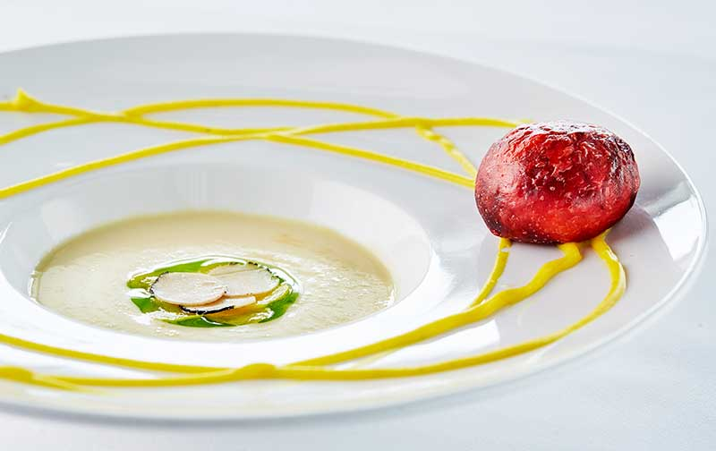 Parsnip cream soup with truffle and red wine bread